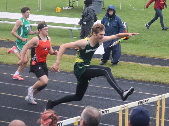Shenandoah senior Max McVicker clears a hurdle during the 300-meter hurdles at the Division III regional meet. McVicker will try to repeat his winning performance during his weekend's OHSAA State Track and Field Championships.