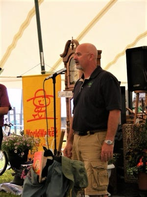 Holmes Park District member Dan Mathie addresses the crowd at a previous benefit auction for the Holmes County Rails to Trails.