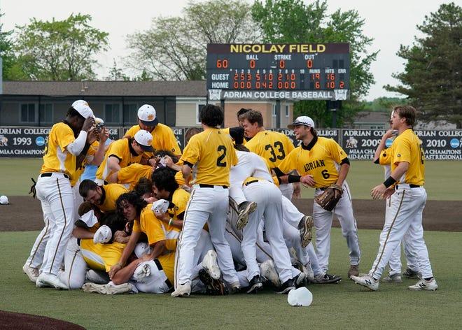 Adrian College baseball celebrates after winning the MIAA championship.