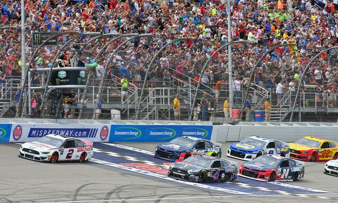 The green flag is waved at the Consumers Energy 400 NASCAR race Aug. 11, 2019, at Michigan International Speedway.