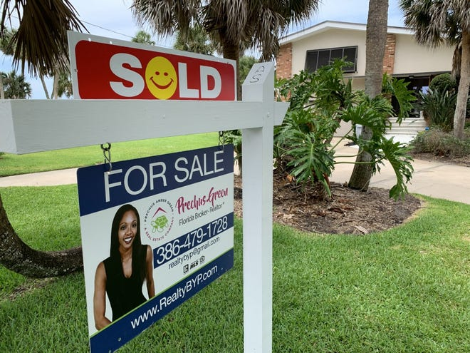 """A """"sold"""" sign can be seen in front of this riverfront home on Riverside Drive in Holly Hill, just south of the border to Ormond Beach on Thursday, June 3, 2021. Independent real estate broker Prechus Green represented the buyers, a couple from New Hampshire who agreed to pay $660,000 in cash. The house received multiple offers and was put under contract just three days after it went up for sale."""
