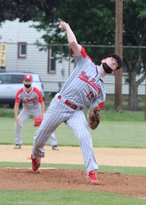 Hornell's Collin Burdett delivers a hard strike to the plate in a stellar performance on Wednesday evening in Maple City Park.