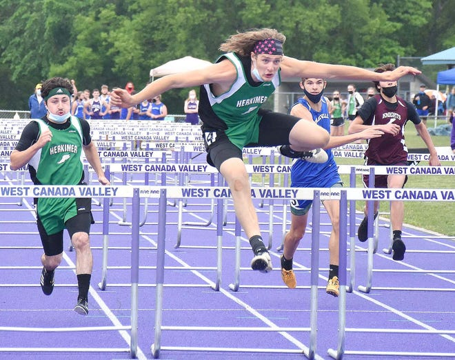 Herkimer Magician Brian Reile (4) soars over the final hurdle with teammate Jesse Richard (left) running second in the 110-meter race at the Center State Conference's Division II championship meet Wednesday.