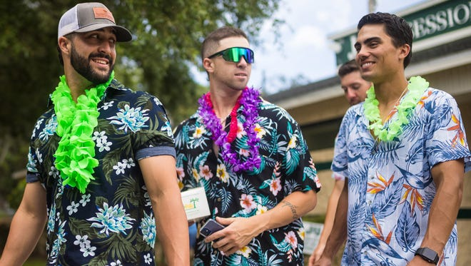 Jacksonville University baseball players (from the left) Adrian Garrastazu, Tyler Santana and Mike Cassala walk to the team bus for the ride to Columbia, S.C., for the NCAA regional.