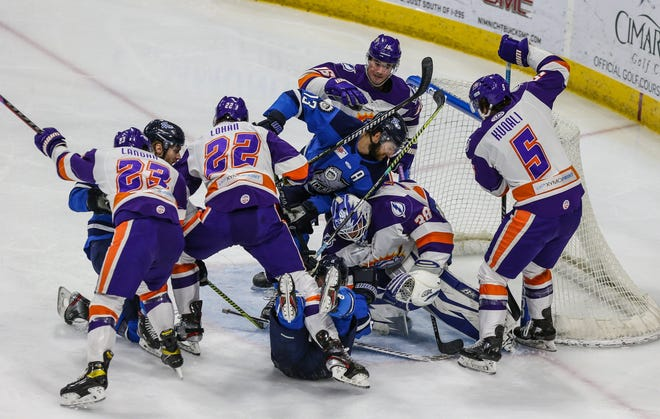 Icemen and Solar Bears players battle for the loose puck around the net of Orlando goaltender Clint Windsor (38) in a May 26 ECHL game.