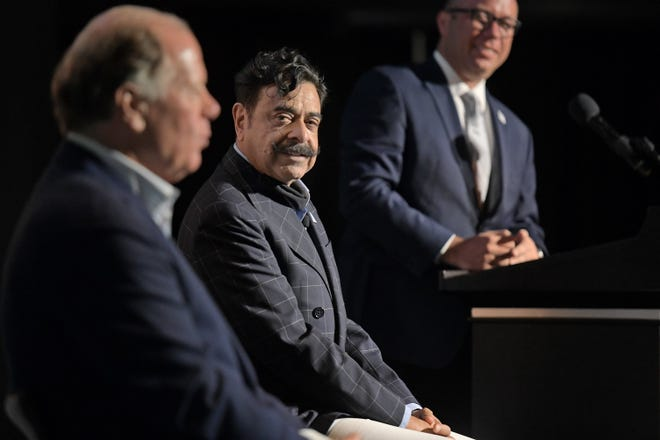 Jacksonville Jaguars owner Shad Khan looks on as team President Mark Lamping answers questions during Thursday morning's event at TIAA Bank Field. The Jacksonville Jaguars presented their latest proposal to develop a Four Seasons hotel on the shipyard property and adjacent Baptist Orthopedic specialty hospital along with plans for a new team training facility which ties into the longer term remodeling of the stadium at TIAA Bank Field Thursday, June 3, 2021. [Bob Self/Florida Times-Union]