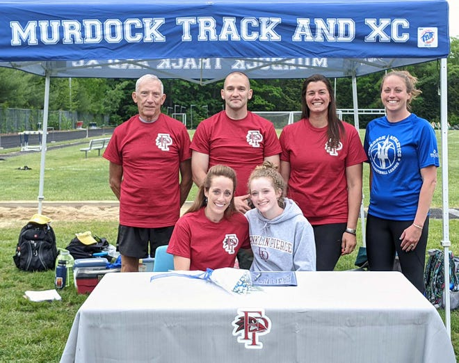 Murdock senior Briahna Bouchard, pictured front right with her mother Debbie Duteau, signed a National Letter of Intent, Wednesday, to run track and cross country at Franklin Pierce University next fall. Joining in the celebration were Murdock track coaches, from left to right, Richard Karvonen, Anthony Findley and Jenn Murphy, and athletic director Jenna Whitaker.