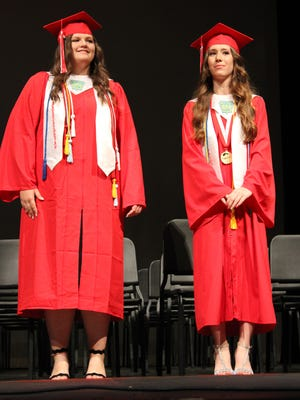 Glen Rose High School Class of 2021 salutatorian Ashlynn Perry, left, and valedictorian Jenna White are presented during commencement on Friday, May 30 in Tiger Stadium.