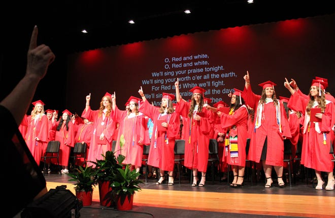 The 141 graduates of the Glen Rose High School class of 2021 sing the school's song during commencement on Friday, May 30, in Tiger Stadium. For more photos, see page A8.