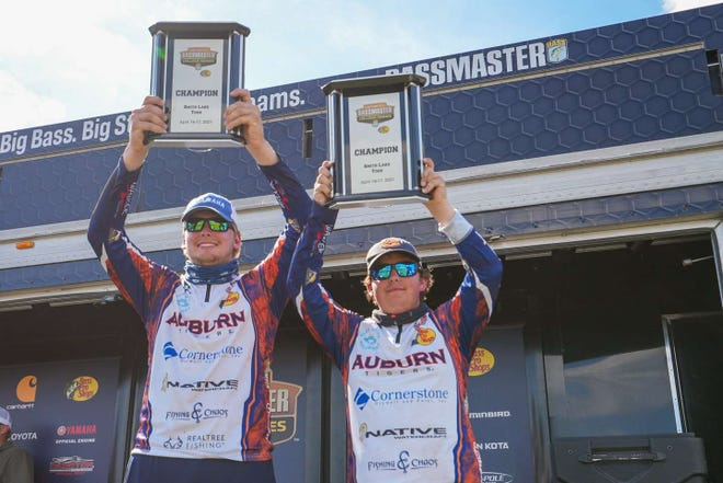 Notre Dame High School grad Connor Jacob (left) and Dunlap High School grad Sam Smith (right) celebrate winning the 2021 Carhartt Bassmaster College Series at Smith Lake in Cullman, Ala., in mid-May, as teammates on Auburn University's fishing team.