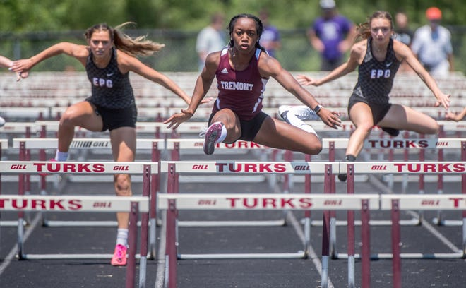Tremont's Cambria Geyer hurdles to the top spot in the 100-meter hurdles Thursday, June 3, 2021 during the Class 1A Girls Track and Field Sectional in Tremont.