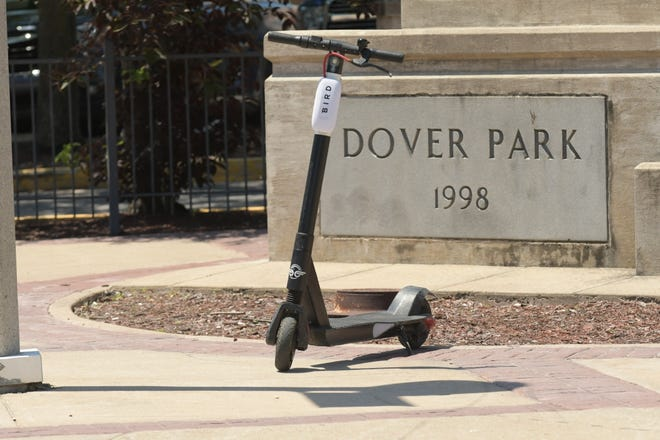 A Bird electric scooter sits in front of Downtown Cinema 8 in Kirksville.