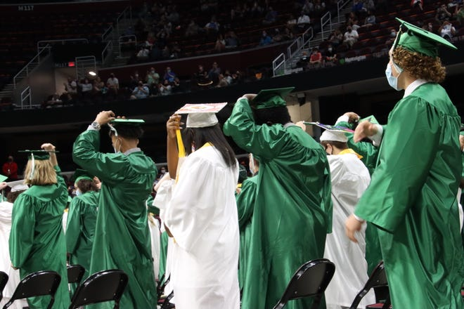 Nordonia High School seniors turn their tassels during the commencement ceremonies.