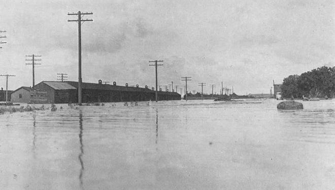A shot taken by local attorney Clyde Davis in 1921 shows flooding near the corner of First Street and Smithland Avenue looking East in La Junta.