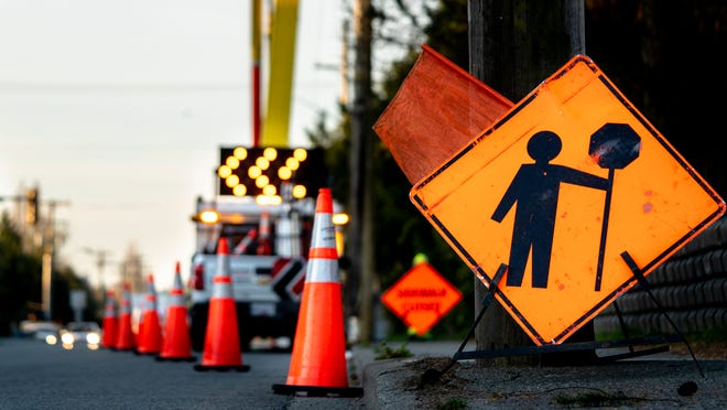 Stock photo of alLane closure on a busy road due to maintenance.