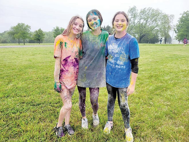Edyn Jackson, Alyssa Streit and Maidson Markley participated in the Kaw Valley Young Life's annual end of school food fight event.