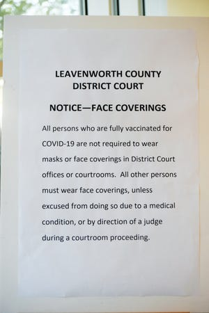 This sign is posted near the entrance to the Justice Center, which houses offices and courtrooms for Leavenworth County District Court.