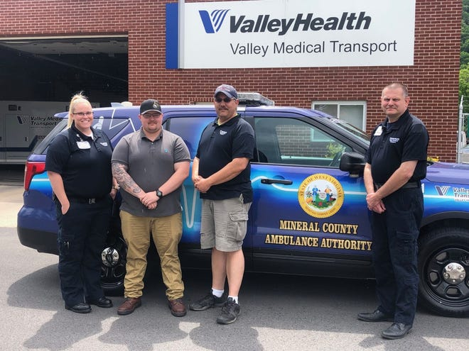 Lauren Trenter, Derek Skinner, Craig Cox and Chris Guynn pose beside Mineral County's chase car outside Valley Medical Transport's  Keyser station. Skinner took his precept paramedic training at Valley and now works for the company.