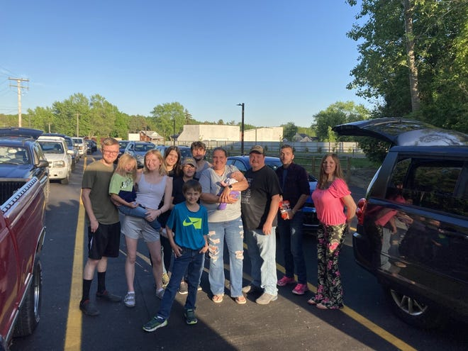 Four generations of the same family gathered for the opening weekend of the Memory Lane Drive-in Theater in Frenchtown Township.