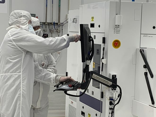 Employees are seen Wednesday working in the cleanroom at Akoustis Technologies in Canandaigua, where U.S. Senate Majority Leader Chuck Schumer talked about a $52 billion investment in science and technology.