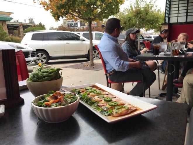 La cena all'aperto dovrebbe essere popolare nel 2021 intorno a 405 ristoranti in posti come Sushi Neko.