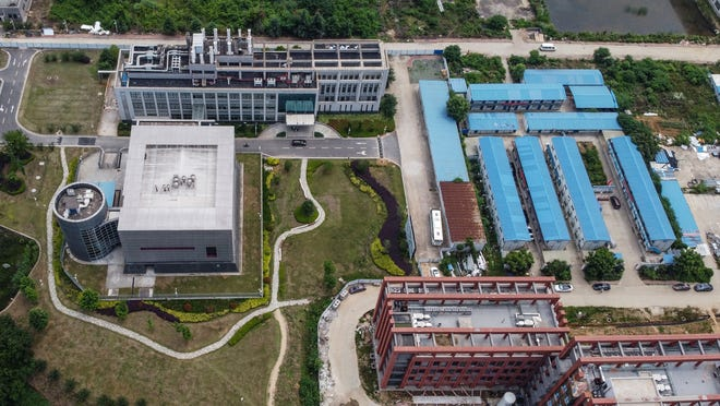 This aerial view shows the P4 laboratory, at left, on the campus of the Wuhan Institute of Virology in Wuhan in China's central Hubei province on May 27, 2020. Opened in 2018, the P4 lab conducts research on the world's most dangerous diseases and has been accused by some top US officials of being the source of the COVID-19 coronavirus pandemic. (Hector Retamal/AFP/Getty Images/TNS)