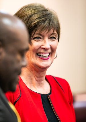 Beth McCall has a laugh with fellow School Board members during a work session in 2019. [Ocala Star-Banner file]2019