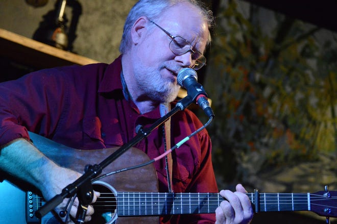 Kevin Johnson performs during a pre-pandemic open mic at the Freshwater Art Gallery and Concert Venue in Boyne City.