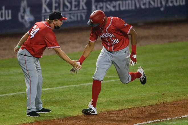 Canada right fielder Michael Crouse (30) rounds third base after connecting on a home run in the seventh inning of the win against Cuba on Tuesday at Clover Park.