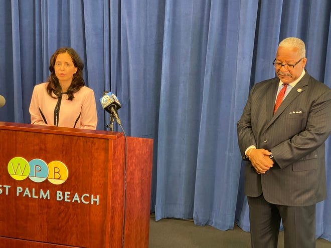 West Palm Beach Director of Public Utilities Poonam Kalkat and West Palm Mayor Keith James discuss the city's water issue Thursday.