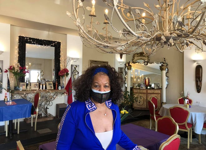 Shut Yo Mouf Soulfood Restaurant co-owner Katrine Nelson-Bey poses for a photo in Old Towne Petersburg on May 8, 2021.