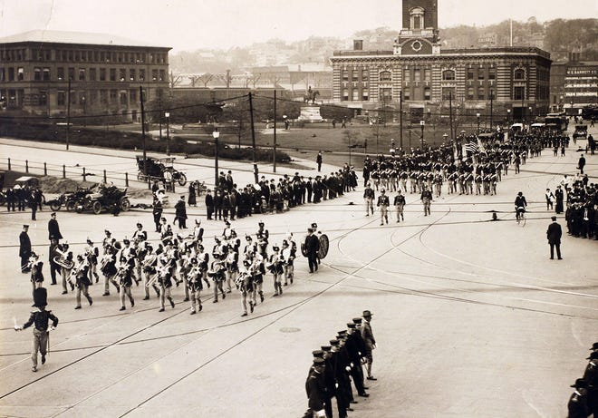 The Rhode Island Infantry parades through downtown Providence in this undated photo from the early 20th century. The old railroad station is at left.