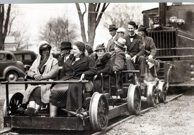 """Patrons try out the seats in the new """"President's Special"""" car that was added to the rail line in April 1938."""