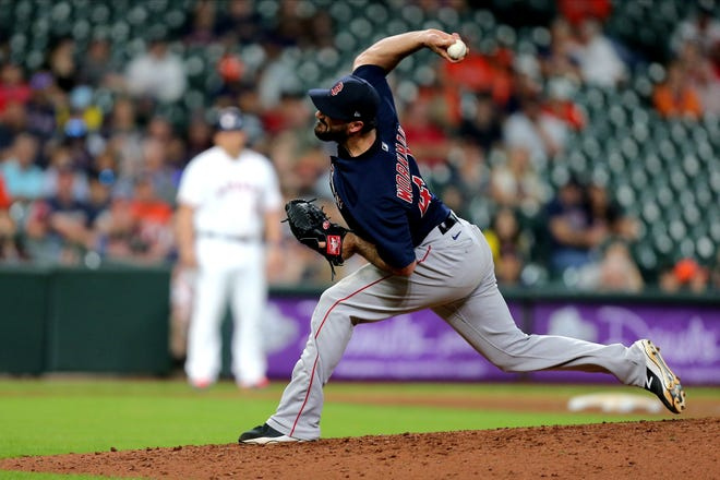 Brandon Workman, who just joined the team on Thursday, delivers a pitch against the Houston Astros in the ninth inning at Minute Maid Park.  Boston won, 5-1.