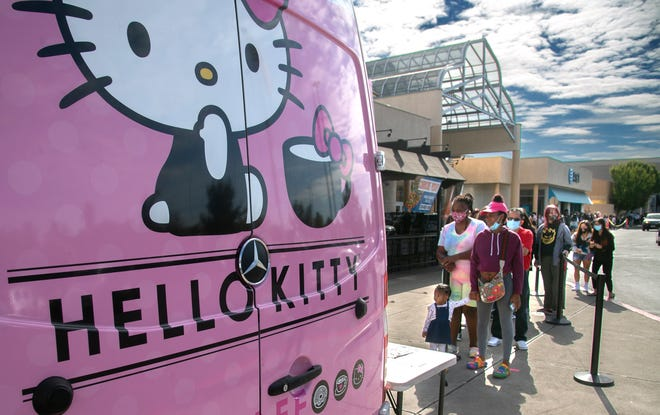 People line up to purchase merchandise from the Hello Kitty Cafe van during an appearance Oct. 10 at Weberstown Mall in Stockton.