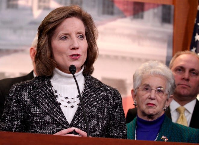 FILE - In this March 25, 2014, file photo, Rep. Vicky Hartzler, R-Mo., left, speaks to reporters on Capitol Hill in Washington, Hartzler, a mid-Missouri Republican, says she'll make an announcement next week on a possible Senate run. Hartzler is among several GOP leaders said to be eyeing the Senate seat being vacated by Republican Roy Blunt, who announced in March he would not seek reelection in 2022. (AP Photo/Lauren Victoria Burke File)
