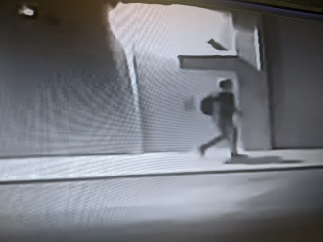 Ravenna police are seeking to identify this person, captured on business security video in a downtown alley Wednesday night, who may be a suspect in a rash of tire slashings over a two-night period.