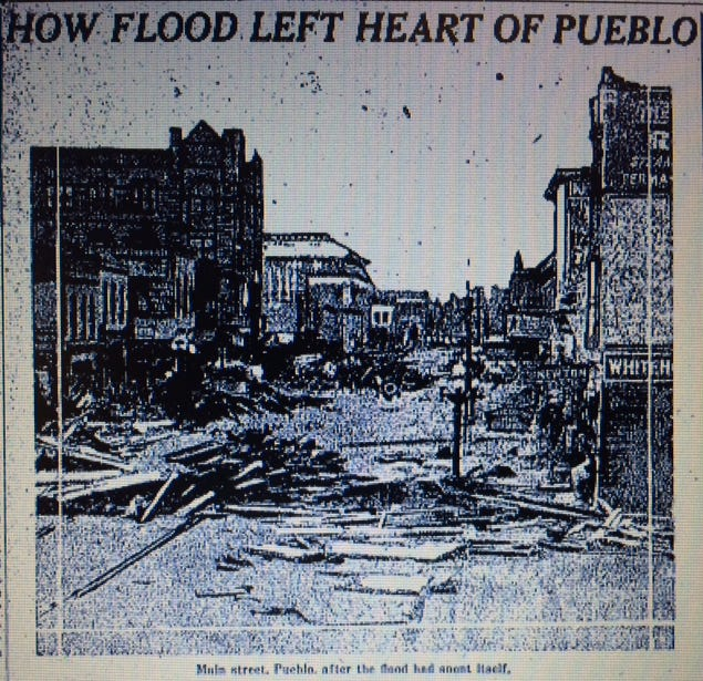 This photograph, published on the front page of The Canton Repository on Thursday June 9, 1921, shows the extent of the damage to downtown Pueblo, Colo. Water covering the business district on Main Street topped 8 feet. When the water receded, it left 2 feet of mud in some places, in which workers prodded in search of victims.