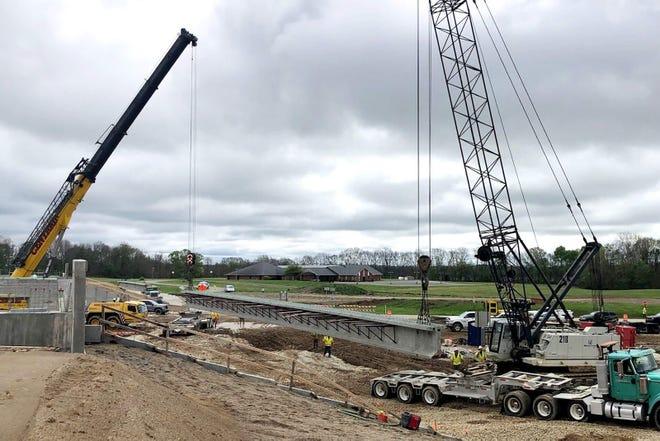 Crews set bridge beams along the future I-69 corridor in Morgan County.
