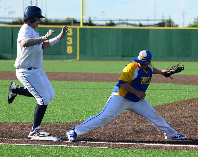 Salina Falcons Parker Benoit crosses first base as Hutchinson first baseman Bennett Turner stretches for the out during the second inning of the first game of the doubleheader at Dean Evans Stadium on Wednesday.