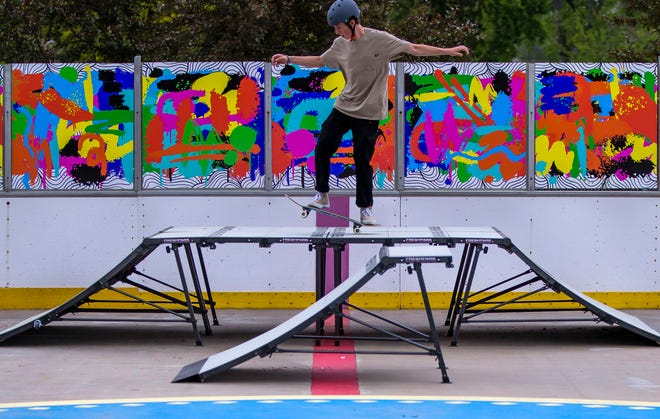 Teagan Marrs manuals across a ramp Wednesday at the new skate area at Merrifield Park Ice Rink.