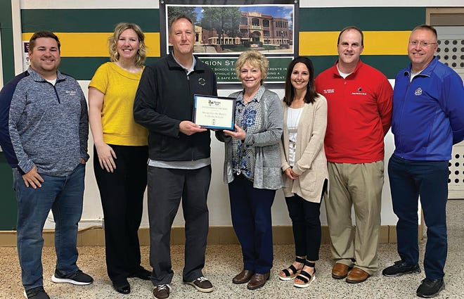 St. Mary'sSchool was recognized as Sleepy Eye Chamber of Commerce Business of the Year at a luncheon on May 28. Pictured are Chamber Board of Directors and St. Mary's Administration, from left: Chamber Board member Scott Salfer, Chamber Executive Director Christina Andres, St. Mary's Principals Peter Roufs and Mary Gangelhoff, Chamber Board member Shelly Kosak, Chamber Board President Matt Wagner, and Chamber Board member John Cselovzki.