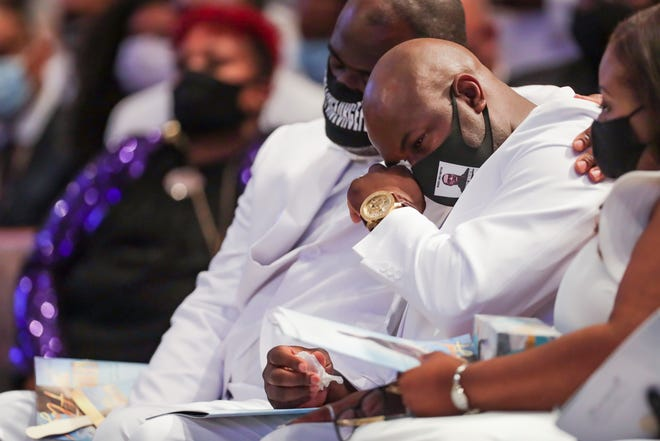 """Rodney Floyd puts his arm around his brother, Philonise Floyd, as they listen to the song """"Oh, How Precious"""" sung during the funeral for their brother, George Floyd, on Tuesday, June 9, 2020, at The Fountain of Praise Church in Houston."""