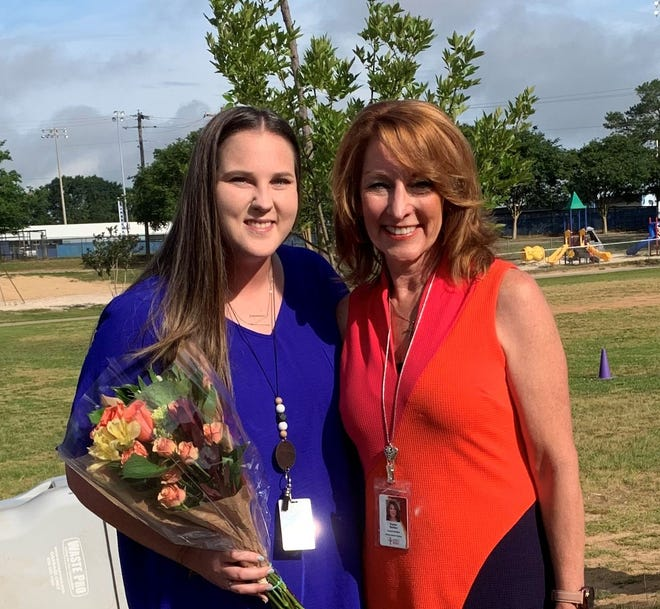 Sydney Nowling, 2021 Santa Rosa Rookie of the Year, left, is pictured withSanta Rosa Schools Superintendent Karen Barber.