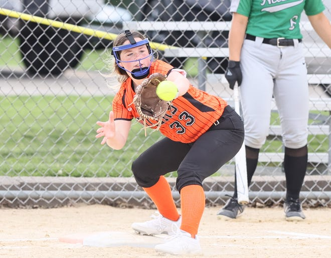 KHS first baseman Ava Lafollette stretches for the putout.