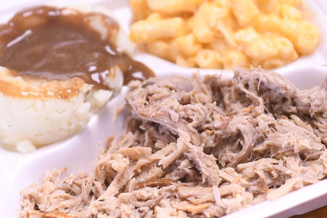 A barbecue plate with macaroni and cheese, mashed potatoes and gravy is served up as guests enjoy lunch Thursday Sept. 17, 2020, at Jackson's Big Oak Barbecue.