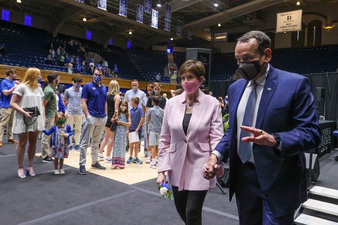 Jun 3, 2021; Durham, NC, USA; Duke Blue Devils basketball head coach Mike Krzyzewski, right, and his wife Mickie leave a press conference at Cameron Indoor Stadium announcing his plan to retire after the 2021-22 season. Mandatory Credit: Nell Redmond-USA TODAY Sports