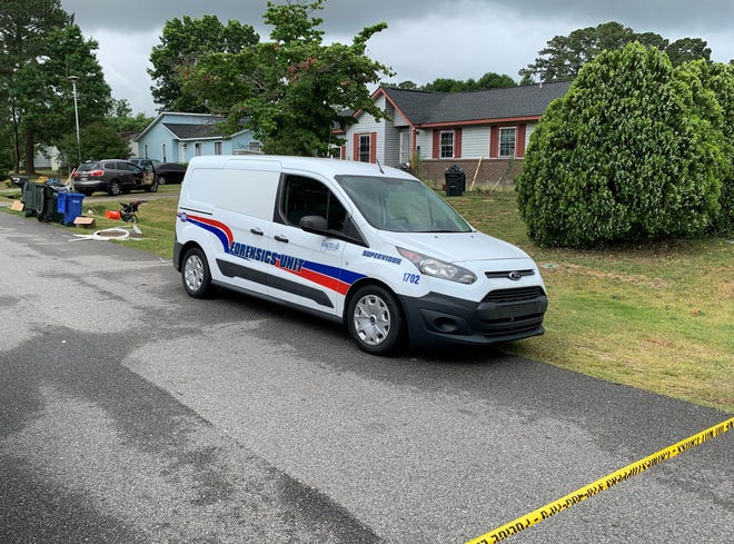 A police forensics van sits outside 6333 Milton Drive on Thursday morning. Fayetteville police say a man was shot and killed there during a home invasion the previous night.