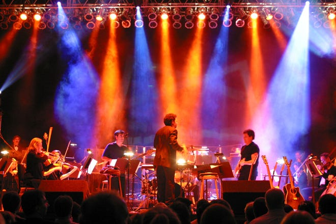 The Windborne Group joins an orchestra on stage for one of its shows melding the sounds of rock music with the full symphony.