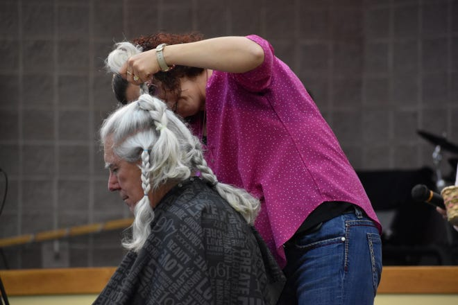 Pastor Bill Johnson of Ecumerical Church of Pueblo West grew his hair to 12-inches long before cutting it and donating to Wigs for Kids.